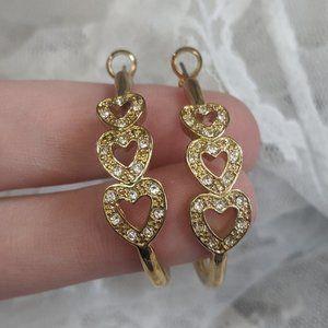 Signed goldtone tri-heart rhinestone hoop earrings